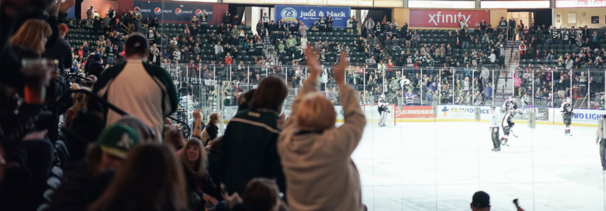 Cheering fans enjoying an Everett Silvertips game.