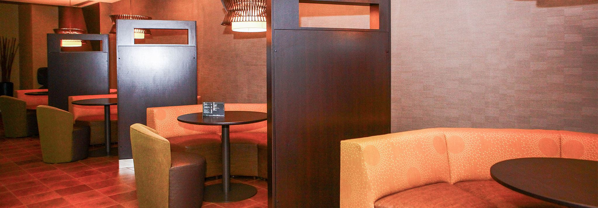 Orange booths with mood lighting in the Marriott's bistro